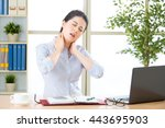 Small photo of Young asian business woman with pain in neck in office