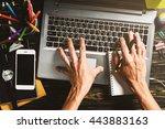 workspace desk  the hand of... | Shutterstock . vector #443883163