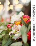 Small photo of Alstroemeria and eucalyptus in wedding decor