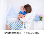 young mother holding her... | Shutterstock . vector #444130483