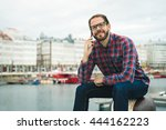 young bearded man talking on... | Shutterstock . vector #444162223
