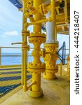 Small photo of Pipeline production and control valve for oil and gas process, Petroleum construction on offshore wellhead remote platform, Energy and petroleum industry, Oil and gas or Petroleum is major of world.