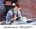 young man working in repair... | Shutterstock . vector #444220477