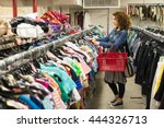 Female Shopper In Thrift Store...