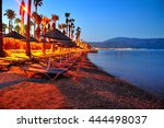 Evening Beach With Sun Beds An...