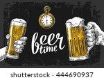 two hands holding beer glasses... | Shutterstock .eps vector #444690937