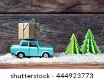 toy car carrying a christmas... | Shutterstock . vector #444923773