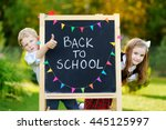 two adorable little schoolkids... | Shutterstock . vector #445125997