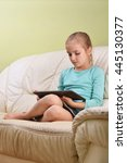 girl using  tablet  sits on... | Shutterstock . vector #445130377