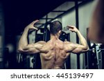 man showing back in gym | Shutterstock . vector #445139497