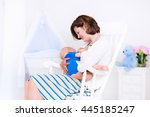 young mother holding her... | Shutterstock . vector #445185247