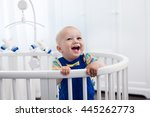 cute laughing baby standing in... | Shutterstock . vector #445262773
