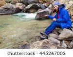 hiker woman taking water from... | Shutterstock . vector #445267003