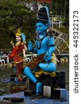 Small photo of marble blue wood statue of a Hinduism snake Shiva vishnu Brahma in a temple near a lake in mauritius africa