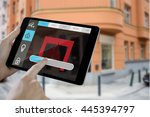 man using tablet pc against... | Shutterstock . vector #445394797