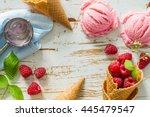 Stock photo raspberry ice cream on white wood background 445479547