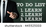 Small photo of Business man pointing with the text: To Do List - Learn, Learn, Learn