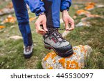 hiker tying boot laces on rock  ... | Shutterstock . vector #445530097