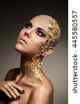 bald model gold bodyart   Shutterstock . vector #445580557