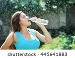 Beautiful Young Woman Drinks...