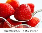 strawberries in a glass dish... | Shutterstock . vector #445714897