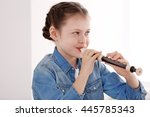 Little Girl Playing Flute On...