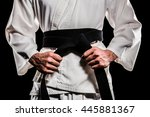 Fighter Tightening Karate Belt...