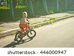 Happy Toddler Boy Riding Bike....