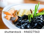 black spaghetti with salmon | Shutterstock . vector #446027563