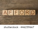 Small photo of AFFORD word on wooden cubes