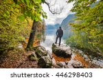 a man stands on rock and... | Shutterstock . vector #446298403