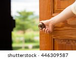 women hand open door knob or... | Shutterstock . vector #446309587