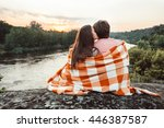 Loving Couple Wrapped In Plaid...