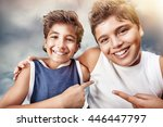 two cute cheerful boys hugging... | Shutterstock . vector #446447797