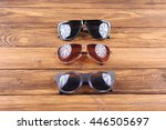 set of sunglasses on wooden... | Shutterstock . vector #446505697