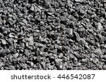 Small photo of coarse-grained texture of a silvery black abrasive material from asphalt stones for wallpaper and for abstract backgrounds