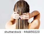 Woman Applying Hair Conditione...