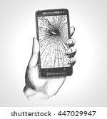 hand holding phone broken... | Shutterstock .eps vector #447029947