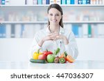 smiling young dietician sitting ... | Shutterstock . vector #447036307
