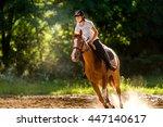 Stock photo young girl riding a horse 447140617
