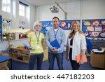 three teachers standing in the... | Shutterstock . vector #447182203