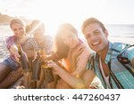 smiling friends with beer at... | Shutterstock . vector #447260437
