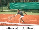 Playing Tennis. Confident Youn...