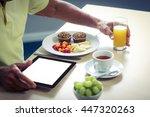 senior man using digital tablet ... | Shutterstock . vector #447320263