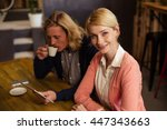 workmates using a tablet... | Shutterstock . vector #447343663