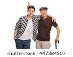 Senior man pranking his grandson with bunny ears isolated on white background