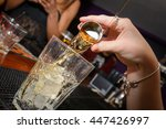 whiskey drink being poured | Shutterstock . vector #447426997