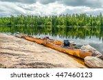 Three Canoes Line A Rocky Shor...