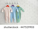 set of baby romper on brick wall | Shutterstock . vector #447529903