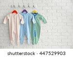 set of baby romper on brick wall   Shutterstock . vector #447529903